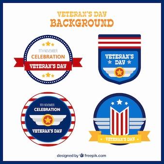 Hintergrund mit vier abzeichen für veteranen-tag