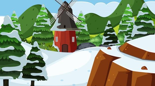 Hintergrunddesign der landschaft mit windmühle auf dem schneegebiet