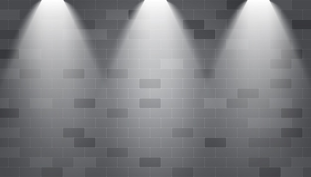 Hintergrundscheinwerfer belichtet auf einer backsteinmauer