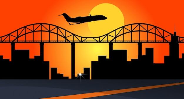 Hintergrundszene mit dem flugzeug, das über stadtgebäude fliegt