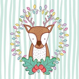 Hirsch mit lichtern und girlande zur weihnachtsdekoration