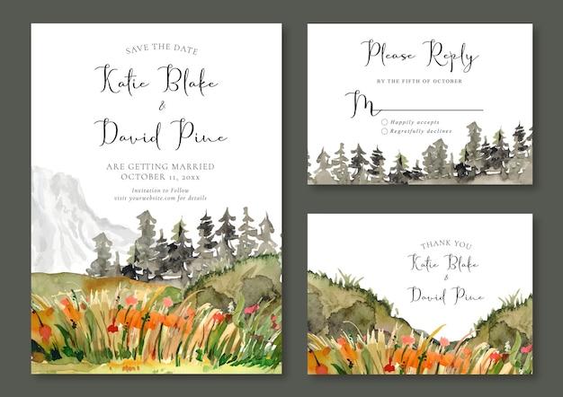 Hochzeitseinladungs-set mit aquarelllandschaft von eisigem berg und grünem feld und orangefarbenen blumen