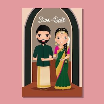 Hochzeitseinladungskarte das niedliche paar der braut und des bräutigams im traditionellen indischen kleid