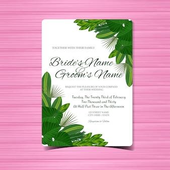 Hochzeitseinladungskarte mit herrlichen tropischen blättern