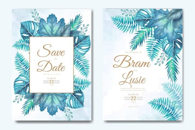 Hochzeitseinladungskarte mit tropischen blättern aquarell