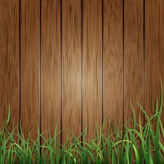 Hölzerne planken und hintergrund des grünen grases