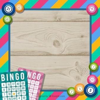 Hölzerner hintergrund mit buntem bingo-rahmen