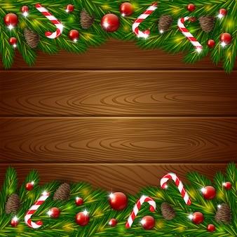 Hölzerner hintergrund und weihnachtstannenbaum mit dekoration
