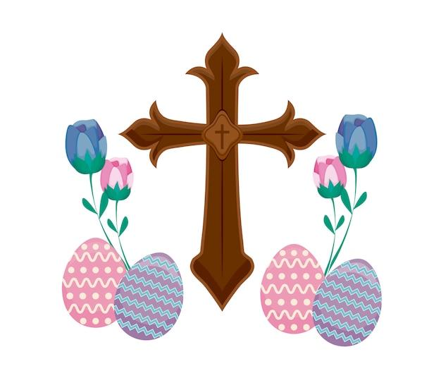 Hölzernes katholisches kreuz mit eiern von ostern und von blumen