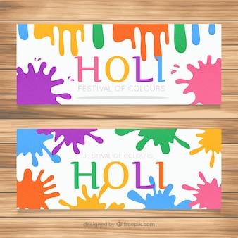 Holi festival banner mit bunten farbflecken