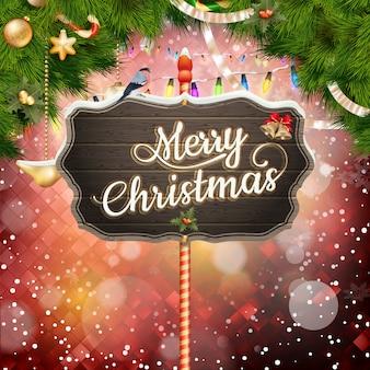 Holz mit weihnachtstannenzweigen.