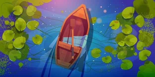 Holzboot auf see draufsicht, boot mit paddel und seidenschal auf wildem teich mit nenuphars oder seerosenblättern.