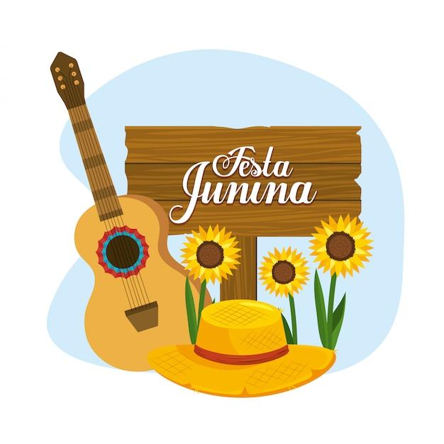Holzemblem mit gitarre und hut zur festa junina