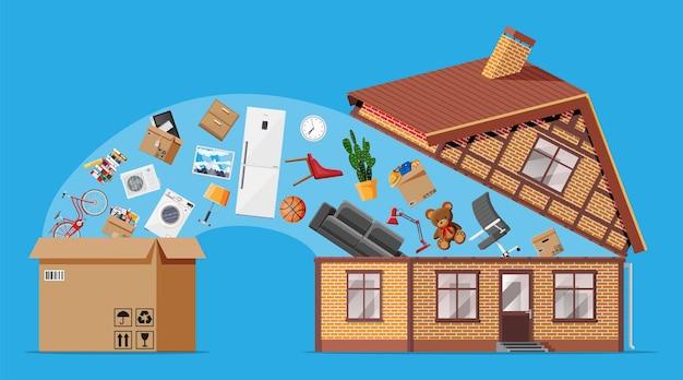 Holzgebäude voller hausrat im inneren. umzug in neues haus. familie in ein neues zuhause umgezogen. kisten mit waren. pakettransport. computer, lampe, kleidung, bücher. flache vektorillustration