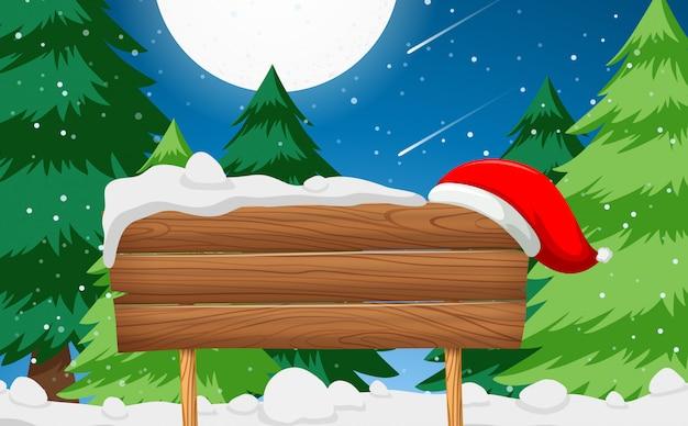 Holzschild mit weihnachtsmütze szene