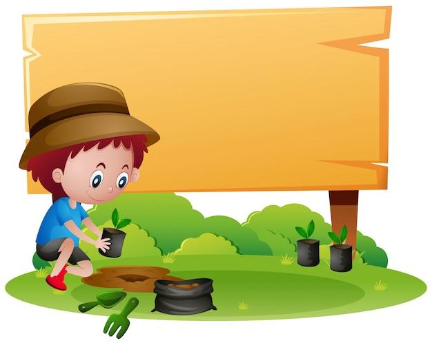 Holzschildschablone mit dem jungen, der baum pflanzt