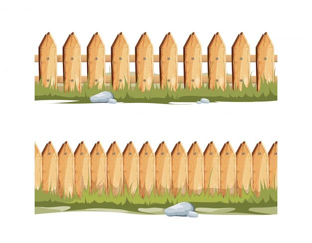 Holzzäune mit gras und steinen