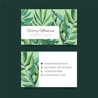 Horizontale doppelseitige visitenkarte mit tropischen blättern