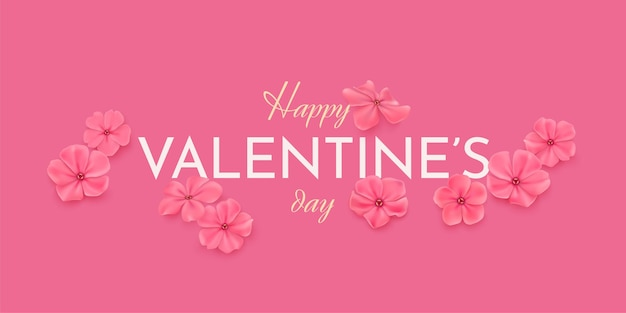 Horizontale grußkarte des glücklichen valentinstags. zarte rosa blumen auf einem rosa hintergrund und glückwunschtext happy valentine's day.