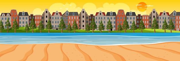Horizontale szene des strandes bei sonnenuntergang mit stadthintergrund
