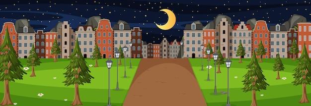 Horizontale szene in der nacht mit langer straße durch den park in die stadt