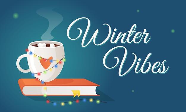 Horizontale winterstimmung, dekoriert mit einer tasse heißgetränkebuch und einer girlande gemütliche urlaubsatmosphäre inmitten der winterfrost-weihnachts- und neujahrsvorbereitungen