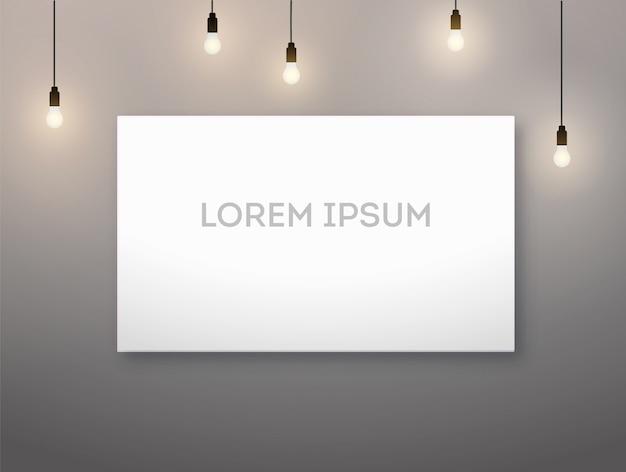Horizontaler bilderrahmen und glühlampe, lampe. warmes licht.