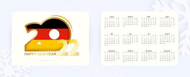 Horizontaler taschenkalender 2022 in deutscher sprache. neujahr 2022-symbol mit flagge deutschlands.