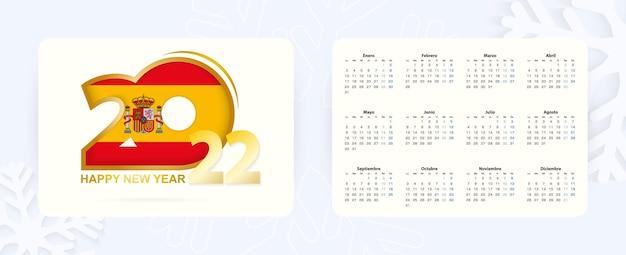 Horizontaler taschenkalender 2022 in spanischer sprache. neujahr 2022-symbol mit flagge von spanien.