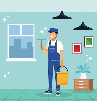 Housekeeping männlicher arbeiter mit sauberer glasbürste und eimer
