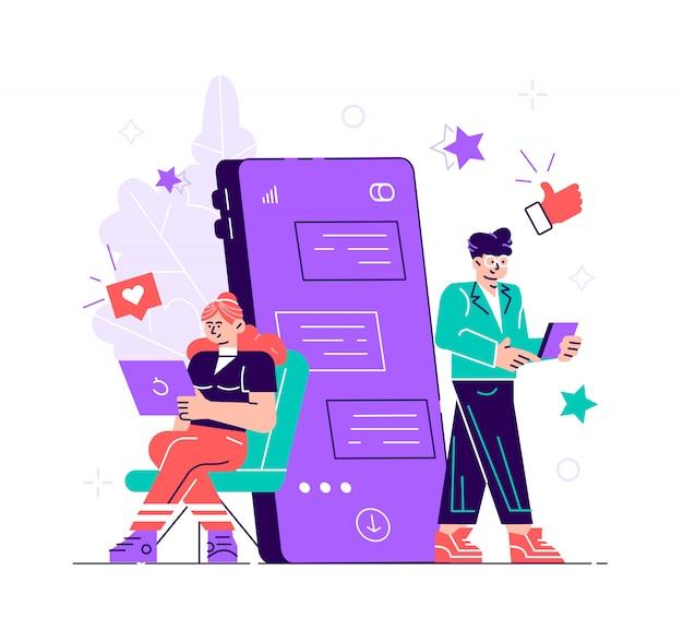 Hübsche frau sitzt an ihrem laptop und plaudert mit gutaussehendem mann mit riesigem telefon und emoji auf dem hintergrund. dating app und virtuelle beziehung. chat-blase. flache art moderne illustration