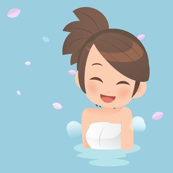 Hübsche mädchen, die in onsen heißen quellen bad nehmen.