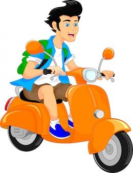 Hübscher junge, der roller reitet