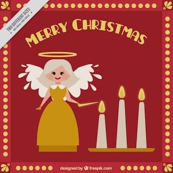Hübsches weihnachtskarte mit engel anzünden von kerzen