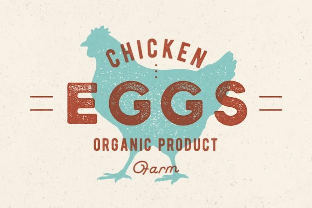 Hühnereier. vintage handgezeichnetes logo, retro-druck, mit shilouette-huhn, hahn.