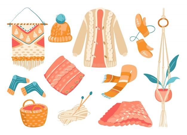Ikonensatz der winterstrickkleidung und der strickwerkzeuge lokalisiert auf weiß. mütze mit pompon, schal und fäustling aus winteraccessoires. gestrickte socken, kissen, kariertes dickes garn