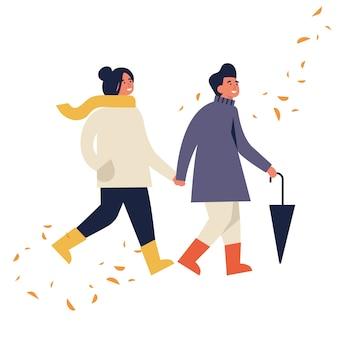 Illustration des glücklichen paares in der herbstsaisonkleidung. junges paar, das geht und sich hält, umgeben von fallenden blättern.