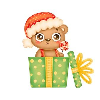Illustration des niedlichen karikaturweihnachtsbären, der roten hut mit lutscher in einer grünen geschenkbox trägt