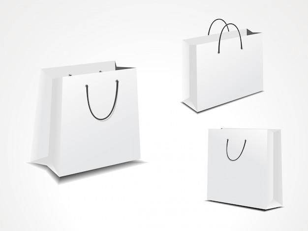 Illustrationssatz von drei papiereinkaufstaschen.