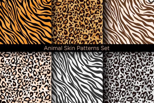 Illustrationssatz von nahtlosen tierdrucken. tiger und leopard muster sammlung in verschiedenen farben im stil.