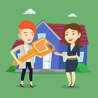 Immobilienmakler geben schlüssel an neuen hausbesitzer.