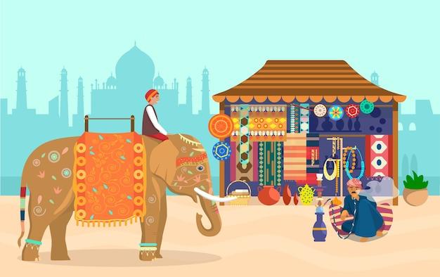 Indische landschaft elefantenreiter taj mahal silhouette souvenirladen