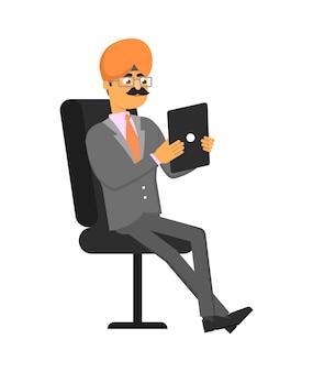 Indischer geschäftsmann mit tablet-computer