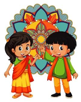 Indischer junge und mädchen mit mandala im hintergrund