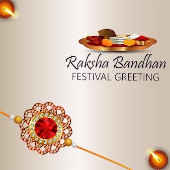 Indisches festival fröhliche rakhi-feierkarte mit kristall und goldenem rakhi mit pooja-platte