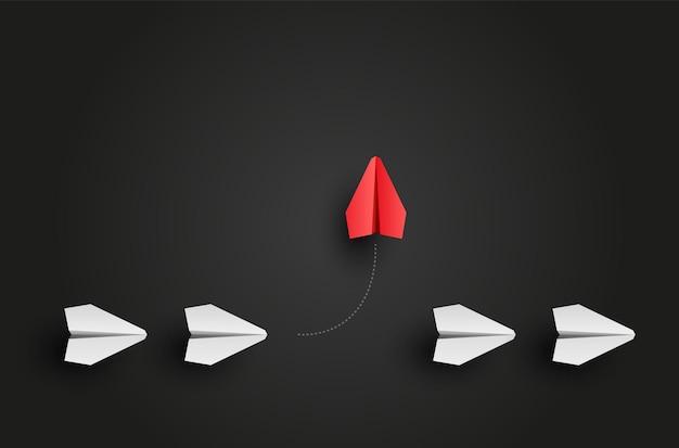 Individualitätskonzept. individuelles und einzigartiges rotes papierflugzeug des anführers fliegt zur seite. illustration