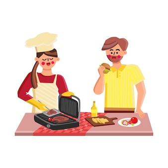 Indoor grill fry fleisch mädchen und jungen zusammen vektor. junger mann, der burger isst, und frau, die steaks auf innengrillausrüstung braten. zeichen, die werkzeug und zutaten-flache cartoon-illustration grillen