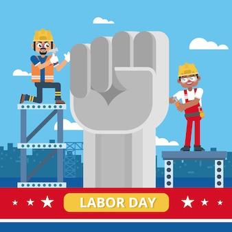 Industriearbeiter feiern werktag mit faust-statue