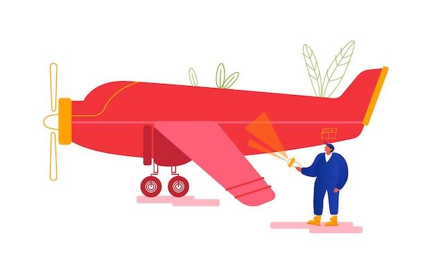 Ingenieur inspektion der flugzeugrumpfbeleuchtung am flugzeugkörper mit taschenlampe, um schäden vor dem flug zu suchen.