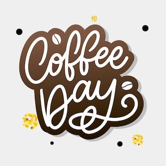 International coffee day schriftzug mit kaffeebohnen.